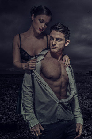 Sexy Young Couple Fashion Photo, Isolated Dark Gloomy Background