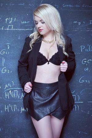 Foto de sexy blonde teacher wearing lingerie on the front of the blackboard chalk - Imagen libre de derechos