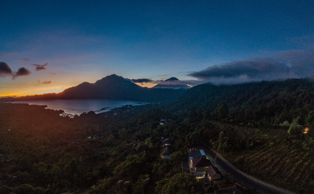 View of Batur lake and Mount Agung during beautiful sunrise in Bali, Indonesia