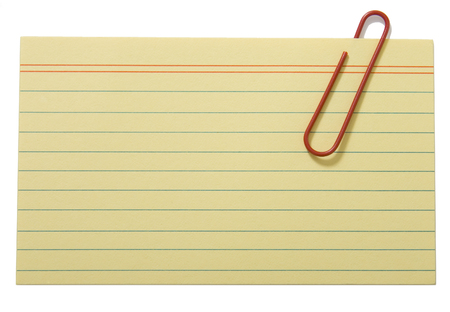 Yellow lined paper fastened with a clip