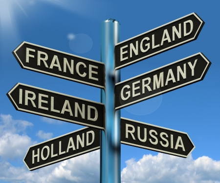 Foto de England France Germany Ireland Signpost Shows Europe Travel Tourism And Destinations - Imagen libre de derechos