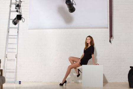 Photo pour Fashion model posing in professionally equipped studio - image libre de droit