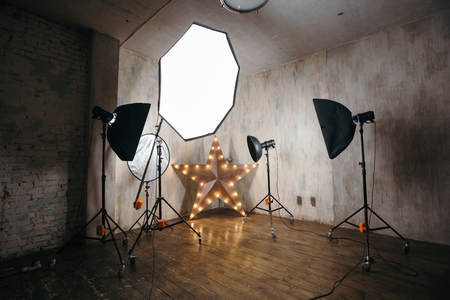 Photo for Modern photo studio interior with professional lighting equipment - Royalty Free Image
