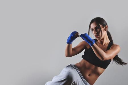 Foto de fitness woman with the blue boxing bandages, studio shot - Imagen libre de derechos