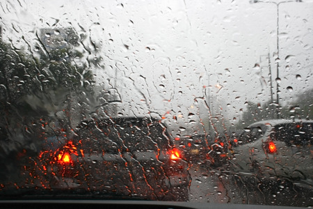 Road view through car window with rain drops, Driving in rain.の写真素材