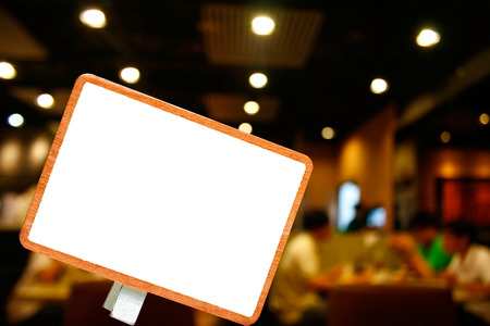 Blank blackboard and customer at restaurant blur background with bokeh
