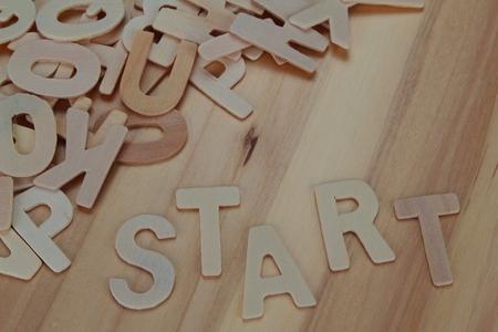 Photo pour Word start made with wooden letters alphabet - image libre de droit