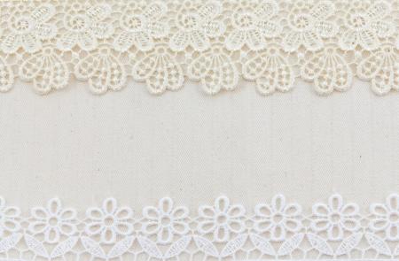 Photo pour Lace flowers frame close up isolated on Fabric texture - image libre de droit