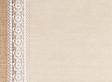 Photo pour Lace flowers frame on Fabric texture background - image libre de droit