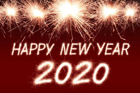 Photo pour Happy new year, 2020 written with Sparkle firework - image libre de droit