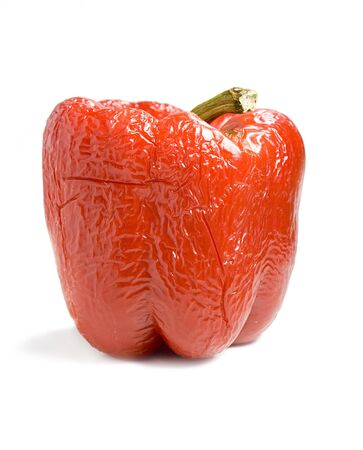 Photo of an old red bell pepper over white
