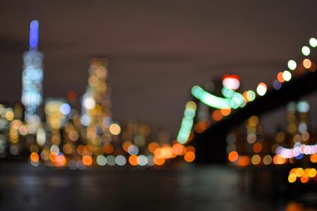 Blurred lights of Brooklyn Bridge and New York City Manhattan. Night view
