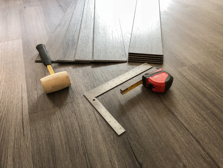 Photo for Luxury flooring concept. Vinyl plank laminate floor. Worker preparing for new floor installation. - Royalty Free Image
