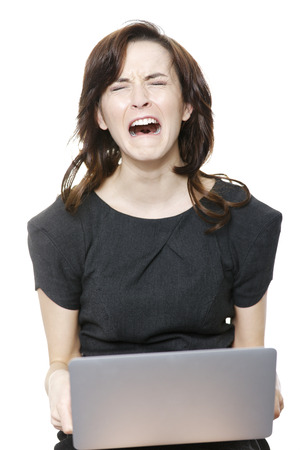 Business woman using laptop expressing concern and worry isolated on white background