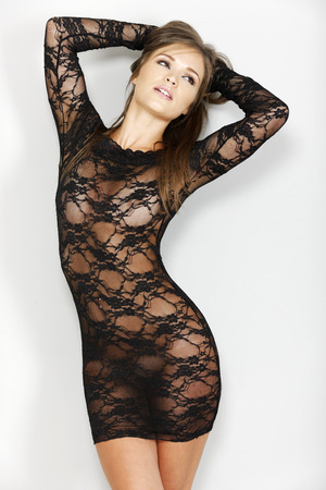 Sexy woman in black one piece lingerie which is sheer