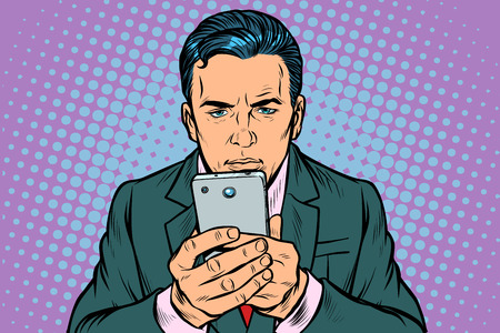 man looks at the smartphone. Pop art retro vector illustration vintage kitsch