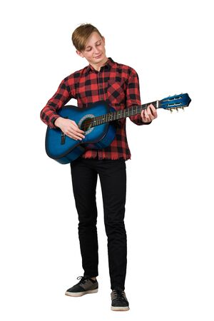 Photo for Full length portrait of proud boy teenager playing on the acoustic guitar isolated over white background. Music lessons for students. Talented guy want to become a famous musician. - Royalty Free Image