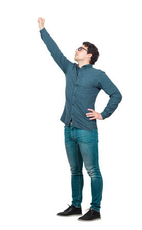 Photo pour Cheerful businessman, full length portrait, raising one arm as a leader, looking up confident. Brave guy, winning gesture isolated on white background. Ambition and business success concept. - image libre de droit