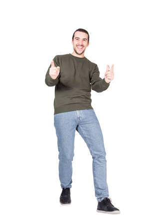 Photo pour Full length portrait of joyful and carefree young man in a dancing move, points forefingers to camera, smiling broadly. Stylish contented guy greeting someone with friendly gesture, isolated on white - image libre de droit