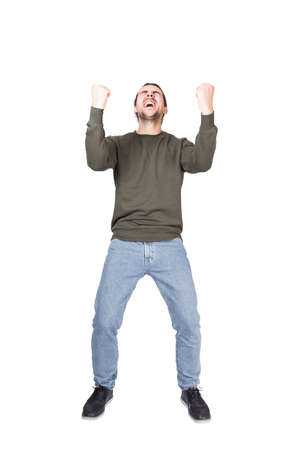 Photo pour Full length portrait hysterical and passionate young man winner, keeps fists tight, shouting and screaming, isolated on white background. Contented guy celebrates success achieve like crazy - image libre de droit