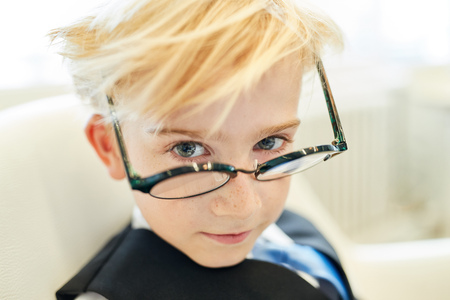 Photo for Boy with glasses as a smart pupil or student or businessman in the office - Royalty Free Image