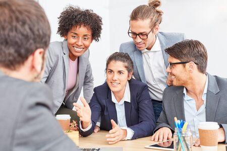 Photo pour Business woman with colleagues in a negotiation about a cooperation - image libre de droit