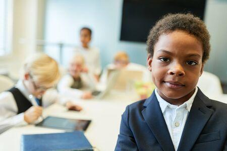 Foto de African child as a businessman or entrepreneur in front of his business team - Imagen libre de derechos
