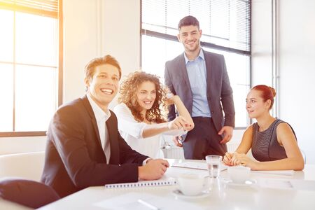 Photo for Young start-up business team has fun in the office and throws paper - Royalty Free Image