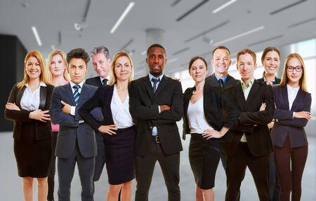 Foto de Team of business people in teamwork standing as group in office (3D Rendering) - Imagen libre de derechos