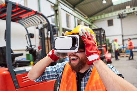 Photo for Amazed worker with VR glasses to visualize the factory of the future as virtual reality - Royalty Free Image
