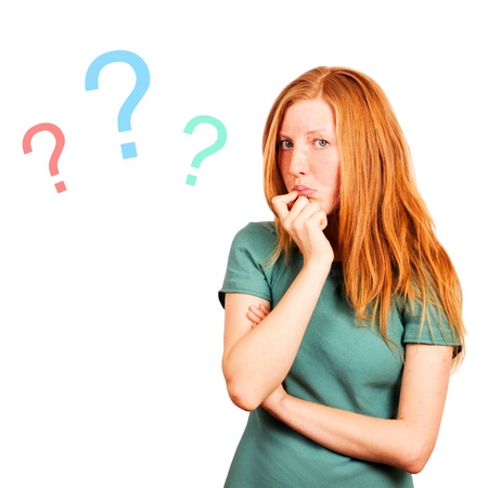 thinking red-haired girl isolated on a white, questions marks at background.