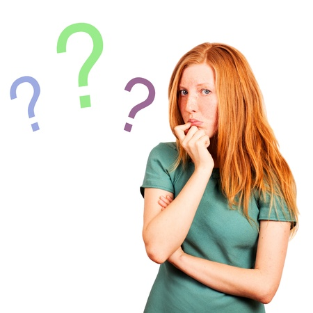 thinking red-haired girl isolated on a white, questions marks at background
