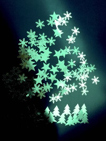 Northern Lights fantasy of fir trees, stars sky and snow