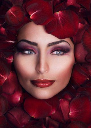 Beautiful Woman's Face and rose petals.Perfect Skin