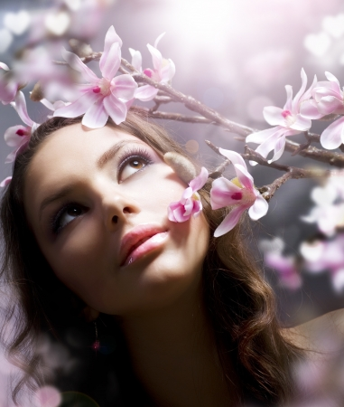 Beautiful Spring Girl with flowersの写真素材