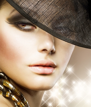 Beautiful Woman over luxury gold backgroundの写真素材