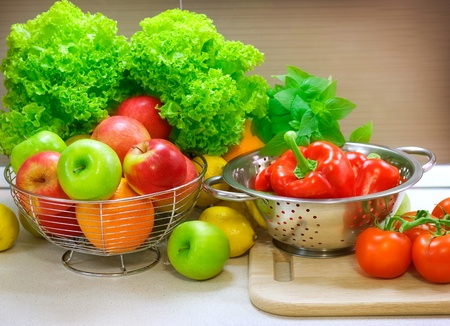Photo for Fresh Raw Vegetables on the kitchen table. Diet - Royalty Free Image
