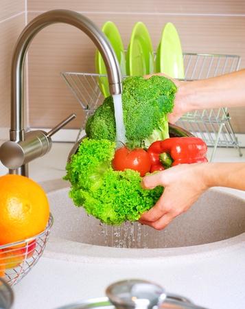 Photo pour Fresh Vegetables Washing  - image libre de droit