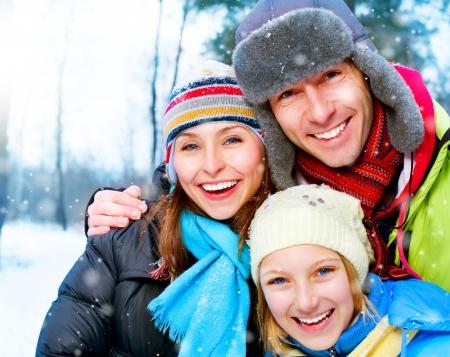Foto de Happy Family Outdoors. Snow. Winter Vacation - Imagen libre de derechos