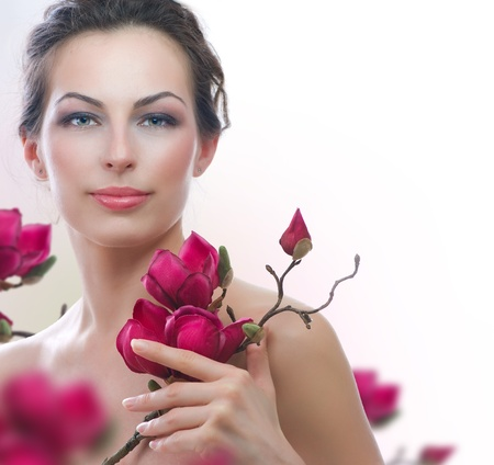 Beautiful Healthy Woman with Spring Flowers  Spa