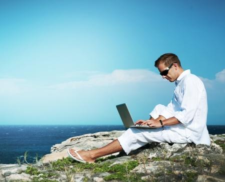 Photo pour Young Man with Laptop Outdoor  - image libre de droit