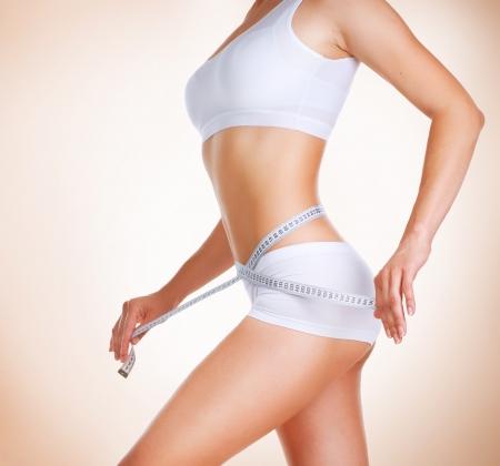 Photo pour Woman measuring her waistline  Diet  Perfect Slim Body  - image libre de droit