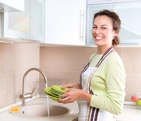 Dishwashing  Happy Young Woman Washing Dishes
