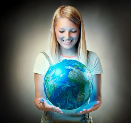Girl holding the Planet Earth  Environment Concept