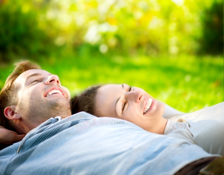 Park  Young Couple Lying on Grass Outdoor