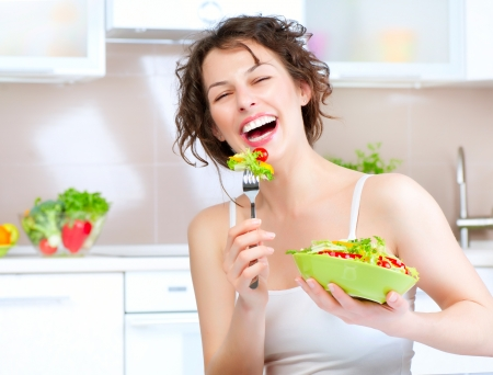 Diet  Beautiful Young Woman Eating Vegetable Salad