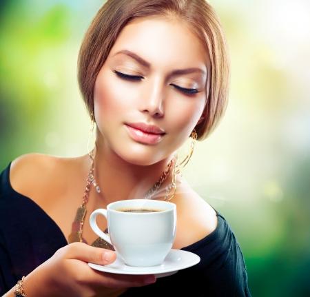 Beautiful Girl Drinking Tea or Coffee