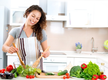 Young Woman Cooking  Healthy Food - Vegetable Salad