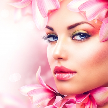 Photo for Beautiful Girl With Orchid Flowers  Beauty Woman Face  - Royalty Free Image