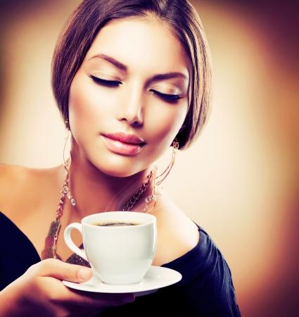 Beautiful Girl Drinking Tea or Coffee  Sepia Toned